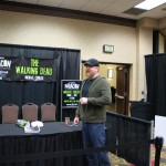 Michael Cudlitz getting ready after pushing his table back so he could be able to hug and be more personal with the fans