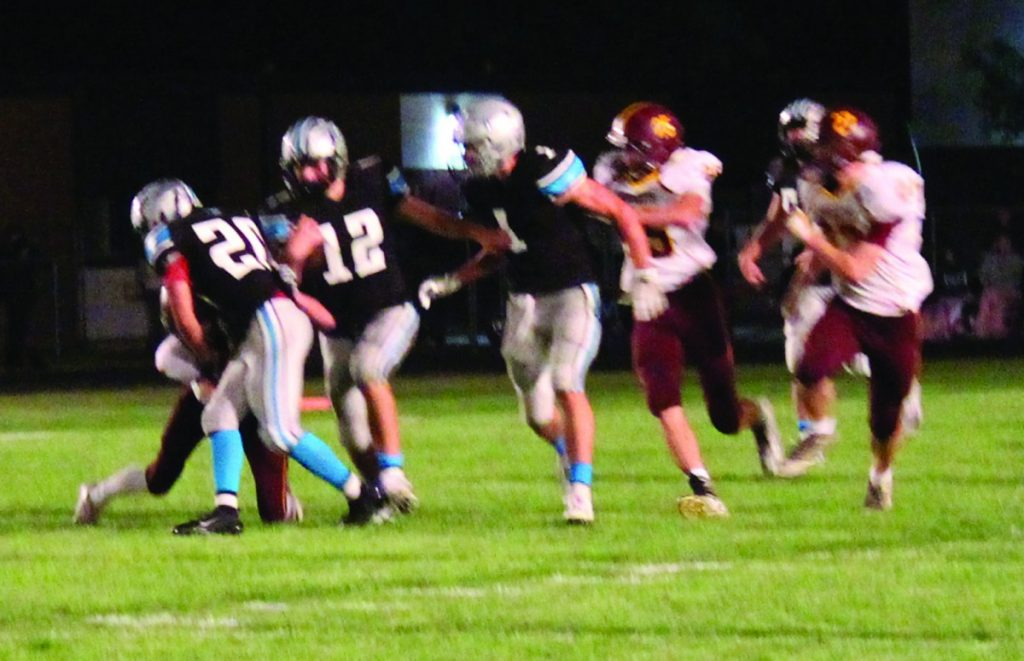 Gaining Yards on the field on Thursday night, Jon Starkey carries the ball with Parker Syverson right beside him.